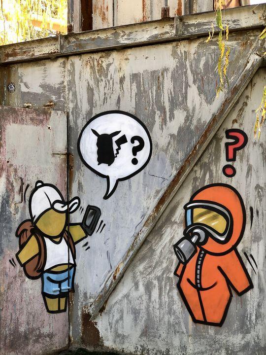 Wie gefährlich ist Tschernobyl (noch)? Dieses Graffiti bringt die Frage auf den Punkt - konkrete Zahlen helfen weiter.